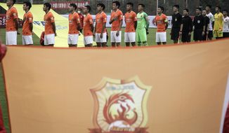 Members of Wuhan FC, then known as Wuhan Zall, prepare for an internal training match in Wuhan in central China's Hubei province on July 2, 2020. The club endured quite an ordeal last year after first being stranded in Spain on a preseason tour as its home city was overrun by the virus, and then fleeing the country just before the outbreak hit Europe hard. (Chinatopix via AP)