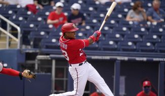 Washington Nationals' Starlin Castro hits a two run home run during the fourth inning of a spring training baseball game against the St. Louis Cardinals, Wednesday, March 10, 2021, in West Palm Beach, Fla. (AP Photo/Lynne Sladky) **FILE**