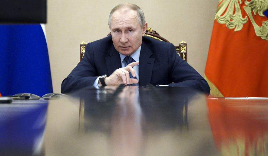 Russian President Vladimir Putin leads a cabinet meeting via video conference in Moscow, Russia, Wednesday, March 10, 2021. (Alexei Druzhinin, Sputnik, Kremlin Pool Photo via AP)