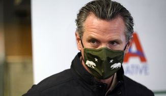 California Gov. Gavin Newsom wears a mask during a visit to a vaccination center Wednesday, March 10, 2021, in South Gate, Calif. (AP Photo/Marcio Jose Sanchez)