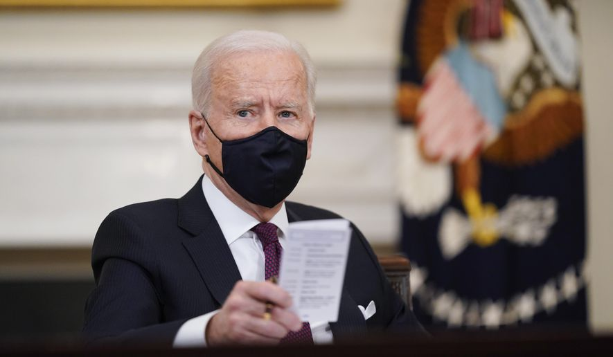 In this March 5, 2021, photo, President Joe Biden participates in a roundtable discussion on a coronavirus relief package in the State Dining Room of the White House in Washington. Biden laid out an ambitious agenda for his first 100 days in office, promising swift action on everything from climate change to immigration reform to the coronavirus pandemic. (AP Photo/Patrick Semansky **FILE**