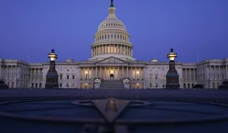 The Capitol is seen just before sunrise in Washington, Friday, March 5, 2021. (AP Photo/Carolyn Kaster)