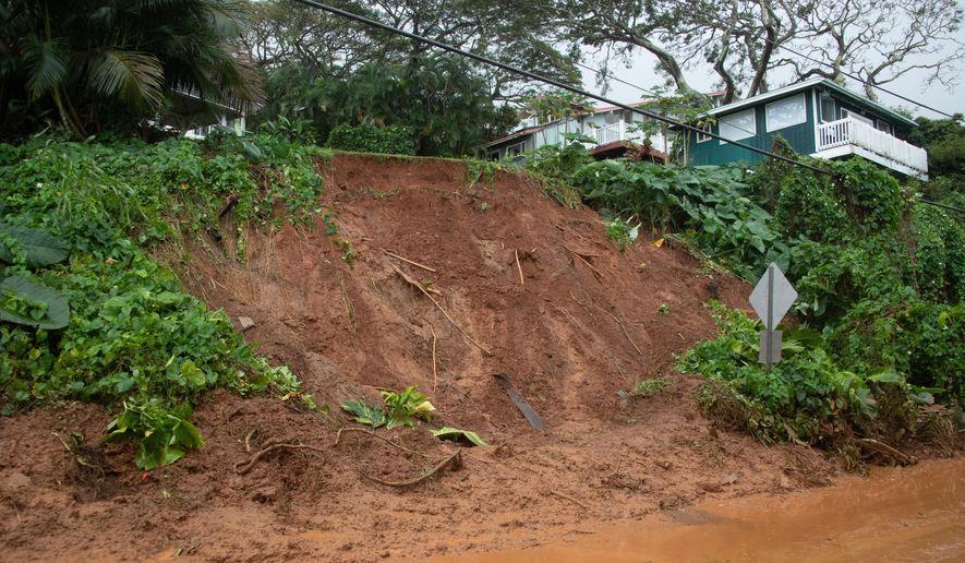 A mudslide leaves Kamehameha Highway coated near Pokole Point on Tuesday, March 9, 2021, near Kahaluu, Hawaii. The entire state was under a flash flood watch amid heavy rains expected to last through Wednesday morning. (Craig T. Kojima/Honolulu Star-Advertiser via AP)