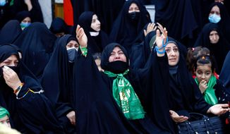 Shiite pilgrims wail as a sign of grief at the golden-domed shrine of Imam Moussa al-Kadhim, who died at the end of the 8th century, during the annual commemoration of his death, in Baghdad, Iraq, Wednesday, March 10, 2021. (AP Photo/Hadi Mizban)