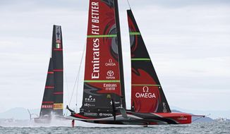 Italy's Luna Rossa, left, and Team New Zealand sail in race one of the America's Cup on Auckland's Waitemata Harbour, Wednesday, March 10, 2021. (Chris Cameron/Photosport via AP)