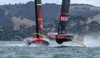 Italy's Luna Rossa, right, and Team New Zealand maneuver for the start of race two of the America's Cup on Auckland's Waitemata Harbour, Wednesday, March 10, 2021. (Chris Cameron/Photosport via AP)