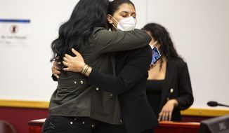 Des Moines Register reporter Andrea Sahouri hugs her mother Muna Tareh-Sahouri after being found not guilty at the conclusion of her trial at the Drake University Legal Clinic, Wednesday, March 10, 2021, in Des Moines, Iowa. An Iowa jury on Wednesday acquitted journalist Sahouri who was pepper-sprayed and arrested by police while covering a protest in a case that critics have derided as an attack on press freedom and an abuse of prosecutorial discretion. (Kelsey Kremer/The Des Moines Register via AP)