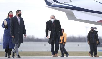 FILE – In this Nov. 18, 2020, file photo, Ohio Governor Mike DeWine, middle, walks away from a plane before the start of a press conference at Toledo Express Airport in Swanton, Ohio. Republican lawmakers' latest in a year-long attempt to rein in DeWine's authority to issue public health orders during the pandemic passed in the House on Wednesday, March 10, 2021 ,and faces a likely veto by the governor. (J.D. Pooley/Sentinel-Tribune via AP, File)