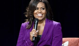 FILE - In this May 11, 2019, file photo, former first lady Michelle Obama speaks during an appearance in Atlanta. Obama and soccer star Mia Hamm are among those chosen for the 2021 National Women's Hall of Fame class announced Monday, March 8, 2021. Former PepsiCo Chief Executive Indra Nooyi and retired Brig. Gen. Rebecca Halstead, the first female commanding general at the strategic level during combat in Iraq, are also included along with several other women. The Women's Hall of Fame induction ceremony is scheduled for Oct. 2, 2021. (Photo by Paul R. Giunta/Invision/AP, File)
