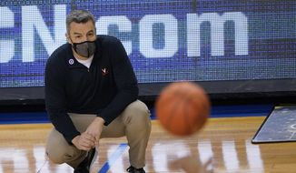 Virginia head coach Tony Bennett watches play during the first half of an NCAA college basketball game against Syracuse in the quarterfinal round of the Atlantic Coast Conference tournament in Greensboro, N.C., Thursday, March 11, 2021. (AP Photo/Gerry Broome) **FILE**