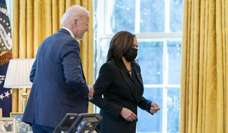 President Joe Biden and Vice President Kamala Harris, smile after Biden signed the American Rescue Plan, a coronavirus relief package, in the Oval Office of the White House, Thursday, March 11, 2021, in Washington. (AP Photo/Andrew Harnik)