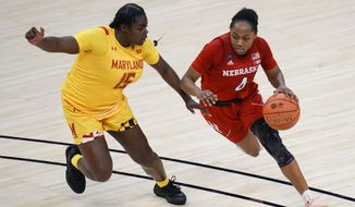 Nebraska guard Sam Haiby (4) brings the ball up court in front of Maryland guard Ashley Owusu (15) in the second half of an NCAA college basketball game in the quarterfinals of the Big Ten Conference tournament in Indianapolis, Thursday, March 11, 2021. Maryland won 83-73. (AP Photo/AJ Mast)