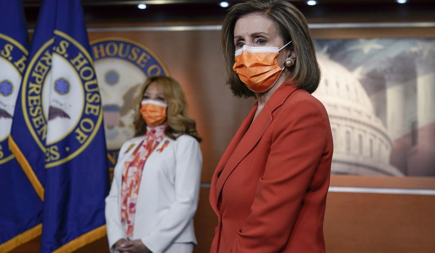 Speaker of the House Nancy Pelosi, D-Calif., joined at left by Rep. Lucy McBath, D-Ga., holds a news conference on passage of gun violence prevention legislation, at the Capitol in Washington, Thursday, March 11, 2021. (AP Photo/J. Scott Applewhite)
