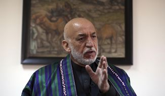 Former Afghan President Hamid Karzai speaks during an interview with the Associated Press in Kabul, Afghanistan, Thursday, March 11, 2021. Afghans are eager for peace and a recently floated U.S. draft for a deal between Taliban insurgents and the Afghan government is the best chance to accelerate stalled peace talks, ex-president Hamid Karzai said in an interview Thursday. (AP Photo/Rahmat Gul)