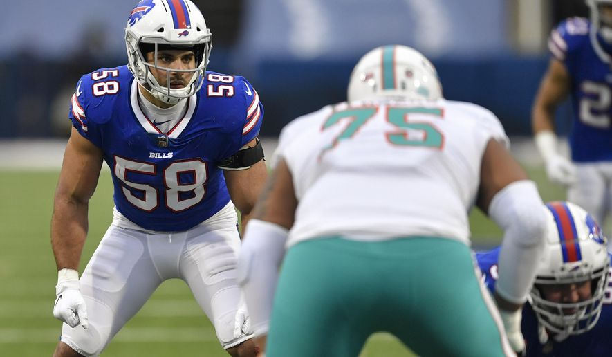 FILE - In this  Sunday, Jan. 3, 2021 file photo, Buffalo Bills outside linebacker Matt Milano (58) sets up for a play in the second half of an NFL football game against the Miami Dolphins in Orchard Park, N.Y. The Buffalo Bills re-signed linebacker Matt Milano to a four-year contract on Thursday, March 11, 2021 less than a week before the three-year starter was eligible to become a free agent. The signing comes a day after the Bills freed up more than $14 million in space under the salary cap by releasing receiver John Brown and defensive lineman Quinton Jefferson.(AP Photo/Adrian Kraus, File)
