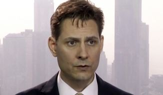 FILE - In this file image made from March 28, 2018, video, Michael Kovrig, an adviser with the International Crisis Group, a Brussels-based non-governmental organization, speaks during an interview in Hong Kong. A Communist Party newspaper says China will soon begin trials for two Canadians, Kovrig and Michael Spavor, who were arrested in December 2018 in apparent retaliation for Canada's detention of a senior executive for Chinese communications giant Huawei Technologies. (AP Photo, File)