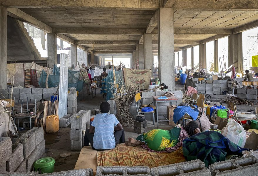 People displaced by the recent conflict live in crowded conditions at a makeshift camp for the displaced in a derelict building of the Shire campus of Axum University, in Shire, in the Tigray region of northern Ethiopia Tuesday, Feb. 23, 2021. (International Rescue Committee via AP)
