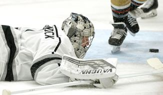 Los Angeles Kings goaltender Troy Grosenick lays on the ice after being scored on by Anaheim Ducks center Sam Steel during the second period of an NHL hockey game Wednesday, March 10, 2021, in Anaheim, Calif. (AP Photo/Mark J. Terrill)