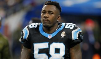 FILE - Carolina Panthers outside linebacker Thomas Davis (58) watches during an NFL football game against the Detroit Lions in Detroit, in this Sunday, Nov. 18, 2018, file photo. Linebacker Thomas Davis and tight end Greg Olsen are signing one-day contracts to retire as members of the Carolina Panthers. A retirement news videoconference is set for March 11. (AP Photo/Paul Sancya, File)