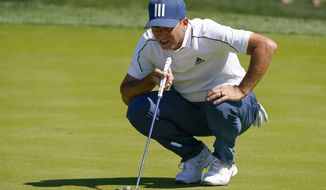 Sergio Garcia, of Spain, lines up a putt on the fifth hole during the first round of the The Players Championship golf tournament Thursday, March 11, 2021, in Ponte Vedra Beach, Fla. (AP Photo/John Raoux)