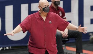 South Carolina head coach Frank Martin watches the action in the first half of an NCAA college basketball game against Mississippi in the Southeastern Conference Tournament Thursday, March 11, 2021, in Nashville, Tenn. (AP Photo/Mark Humphrey)