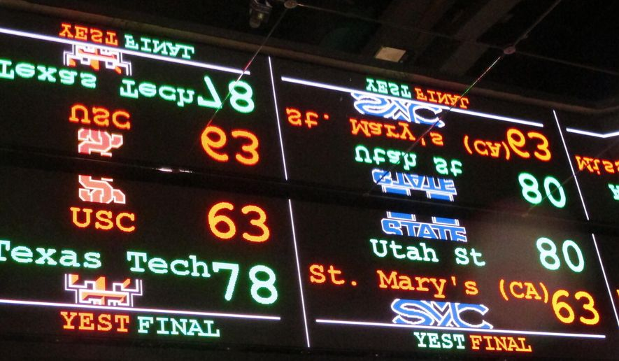 In this Nov. 20, 2018 photo a scrolling video board with basketball scores is reflected in the ceiling of a sportsbook in Atlantic City, N.J. (AP Photo/Wayne Parry)  **FILE**