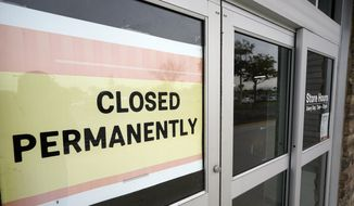 """A business that has closed permanently displays a sign near the entrance, Tuesday, Jan. 12, 2021, in Orlando, Fla.   The """"For Rent"""" signs on storefronts and offices around the world provide a stark illustration of COVID's toll on small businesses. With government restrictions and fear keeping consumers out of restaurants, stores and other establishments, businesses that operate on narrow revenue streams have struggled the past year. Or, they've disappeared, leaving millions of workers unemployed.   (AP Photo/John Raoux)"""