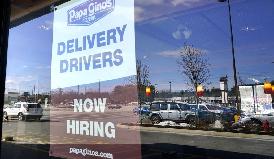 "A ""Now Hiring"" sign is displayed, Thursday, March 4, 2021, in Salem, N.H. U.S. employers added a surprisingly robust 379,000 jobs in February in a sign the economy is strengthening as virus cases drop, vaccinations ramp up, Americans spend more and states ease business restrictions. (AP Photo/Elise Amendola)"