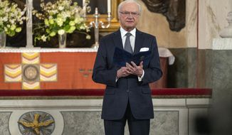 Sweden's King Carl Gustaf reads a text during a Memorial service at Drottningholm Palace Church in Stockholm, Thursday, March 11, 2021. Sweden's King Carl XVI Gustaf and his wife Queen Silvia held a church ceremony on Thursday to honour the victims of the coronavirus, on the one-year anniversary of the first death of the pandemic in the Scandinavian nation. The royal couple participated, but Crown Princess Victoria and Prince Daniel could not attend as they both tested positive for covid-19 earlier in the day. (Jonas Borg/Royal Court of Sweden via AP)