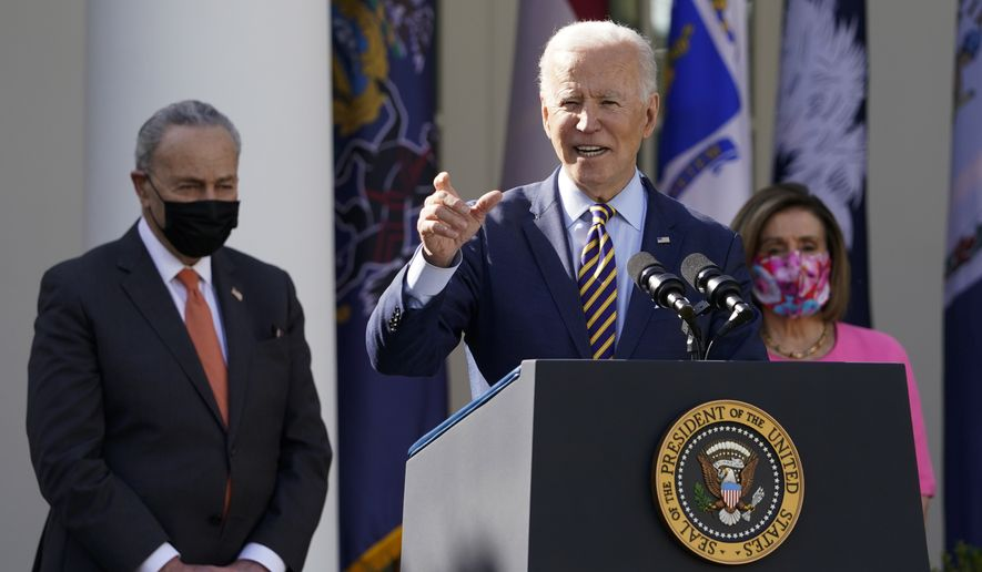 President Joe Biden speaks about the American Rescue Plan, a coronavirus relief package, in the Rose Garden of the White House, Friday, March 12, 2021, in Washington. Senate Majority Leader Chuck Schumer of N.Y., left, and House Speaker Nancy Pelosi of Calif., listen. (AP Photo/Alex Brandon)