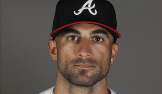 This is a 2020 file photo showing Nick Markakis of the Atlanta Braves baseball team. Markakis has retired after a 15-year career spent with the Atlanta Braves and Baltimore Orioles. The 37-year-old Markakis, who was a free agent, told The Athletic in a story published Friday, March 12, 2021, that he was done playing after accumulating 2,388 hits, earning his lone All-Star bid in 2018 and coming within one win of reaching the World Series in his final season.  (AP Photo/John Bazemore, File)  **FILE**