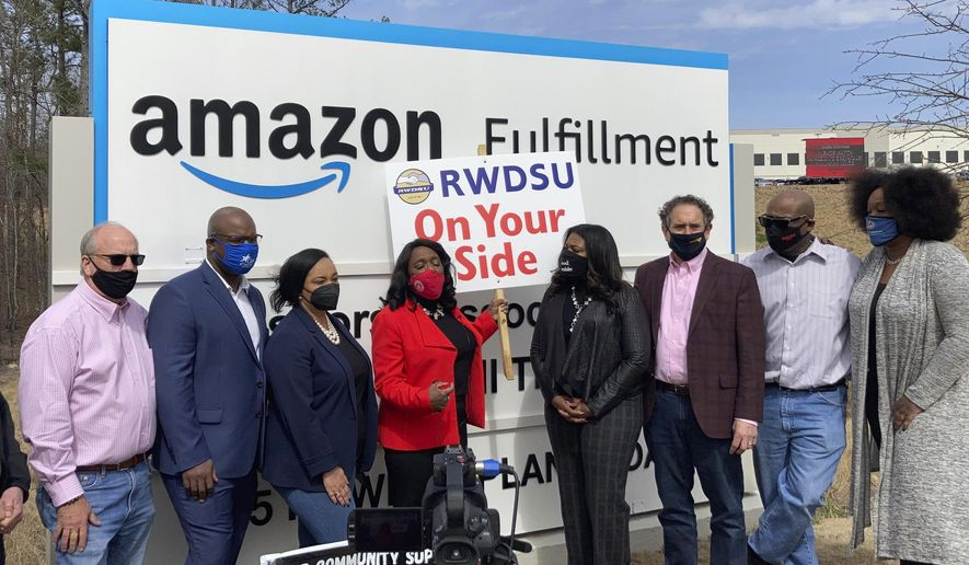 Democratic members of Congress join representatives of the Retail, Wholesale and Department Store Union gather outside an Amazon fulfillment center in Bessemer, Ala., on March 5, 2021, to advocate for the ongoing unionization vote at the sprawling campus. The elected officials pictured include, starting second from left, Rep. Jamaal Bowman of New York, Nikema Williams of Georgia, Terri Sewell of Alabama, Cori Bush of Missouri and Andy Levin of Michigan. (AP Photo/Bill Barrow)