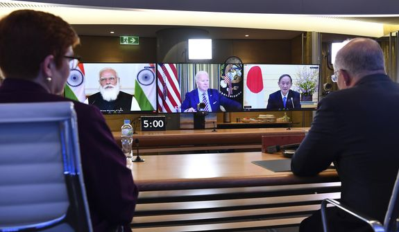 In this file photo, Australia's Prime Minister Scott Morrison, right, and Minister for Foreign Affairs Marise Payne, left, participate in the inaugural Quad leaders meeting with the President of the United States Joe Biden, the Prime Minister of Japan Yoshihide Suga and the Prime Minister of India Narendra Modi in a virtual meeting in Sydney, Saturday, March 13, 2021. (Dean Lewins/Pool via AP)  **FILE**