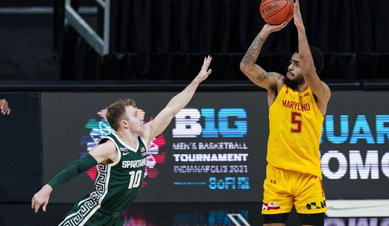 Maryland guard Eric Ayala (5) shoots over Michigan State guard Jack Hoiberg (10) in the second half of an NCAA college basketball game at the Big Ten Conference tournament in Indianapolis, Thursday, March 11, 2021. Maryland defeated Michigan State 68-57. (AP Photo/Michael Conroy)