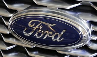 This Feb. 15, 2018, file photo shows a Ford logo on the grill of a 2018 Ford Explorer on display at the Pittsburgh Auto Show. Edsel B. Ford II is retiring from the board of Ford Motor after serving as a board member for 33 years. The automaker also named some other members of the famous family as board nominees. Board nominees will be up for election at Ford's annual meeting on May 13, 2021. (AP Photo/Gene J. Puskar, File)