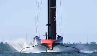 Team New Zealand races to the finish while sailing against Italy's Luna Rossa in race 3 of the America's Cup on Auckland's Waitemata Harbour, Friday, March 12, 2021. (Chris Cameron/Photosport via AP)