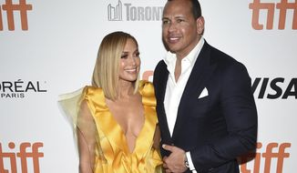 "FILE - In this Saturday, Sept. 7, 2019, file photo, Jennifer Lopez, left, and Alex Rodriguez attend the premiere for ""Hustlers"" on day three of the Toronto International Film Festival at Roy Thomson Hall, in Toronto. Lopez and Rodriguez called off their two-year engagement, according to multiple reports based on anonymous sources. The former New York Yankees shortstop proposed to the actor a couple years ago after the celebrity couple started dating in early 2017. (Photo by Evan Agostini/Invision/AP, File)"