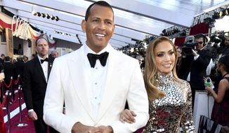 FILE - In this Sunday, Feb. 24, 2019, file photo, Alex Rodriguez, left, and Jennifer Lopez arrive at the Oscars at the Dolby Theatre in Los Angeles. Multiple reports based on anonymous sources say Lopez and Rodriguez called off their two-year engagement. The former New York Yankees shortstop proposed to the actor a couple years ago after the celebrity couple started dating in early 2017. (Photo by Charles Sykes/Invision/AP, File)