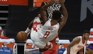 Houston Rockets forward Jae'Sean Tate (8) dunks the ball against the Sacramento Kings during the first quarter of an NBA basketball game in Sacramento, Calif., Thursday, March 11, 2021. (AP Photo/Randall Benton)