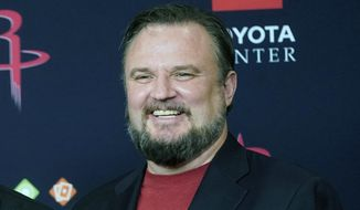 FILE - This is a July 26, 2019, file photo showing Houston Rockets General Manager Daryl Morey during an NBA basketball news conference in Houston.  Morey hasn't had to make any major moves in his first season running the Philadelphia 76ers. But the executive who took the Houston Rockets to the brink of the NBA Finals believes he has the roster in Philly need to win its first NBA title since 1983. (AP Photo/David J. Phillip, File)