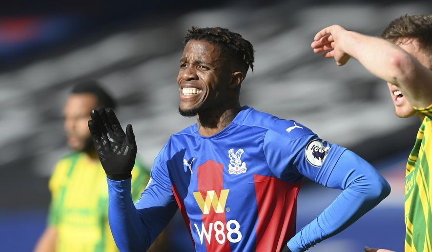 Crystal Palace's Wilfried Zaha reacts during the English Premier League soccer match between Crystal Palace and West Bromwich Albion at Selhurst Park stadium in London, England, Saturday, March 13, 2021.(Mike Hewitt/Pool via AP) **FILE**