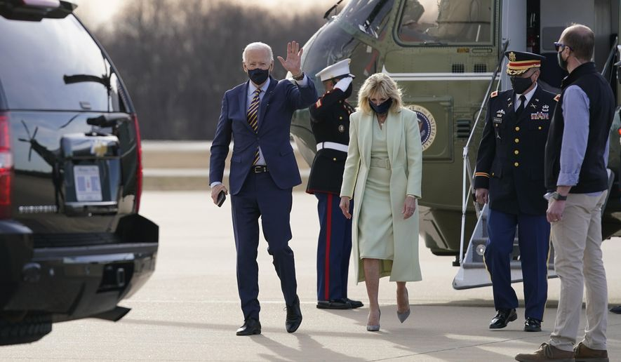 FILE - In this March 12, 2021, file photo President Joe Biden and first lady Jill Biden walk to a motorcade vehicle after stepping off Marine One at Delaware Air National Guard Base in New Castle, Del. The Bidens are spending the weekend at their home in Delaware. (AP Photo/Patrick Semansky, File)