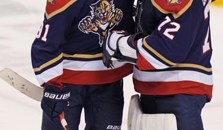 Florida Panthers goaltender Sergei Bobrovsky (72) and left wing Anthony Duclair (91) congratulate each other after the Panthers defeated the Chicago Blackhawks 4-2 in an NHL hockey game Saturday, March 13, 2021, in Sunrise, Fla. (AP Photo/Wilfredo Lee)