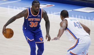New York Knicks forward Julius Randle (30) goes against Oklahoma City Thunder center Al Horford (42) during the second half of an NBA basketball game, Saturday, March 13, 2021, in Oklahoma City. (AP Photo/Garett Fisbeck)