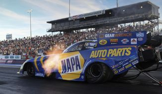 In this photo provided by the NHRA, Ron Capps drives in Funny Car qualifying at the NHRA Gatornationals drag races Friday, March 12, 2021, at Gainesville Raceway in Gainesville, Fla. (Marc Gewertz/NHRA via AP)