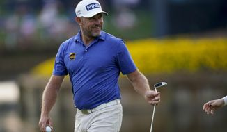 Lee Westwood, of England, smiles after making a birdie putt on the 16th hole during the third round of The Players Championship golf tournament Saturday, March 13, 2021, in Ponte Vedra Beach, Fla. (AP Photo/Gerald Herbert)