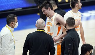 Tennessee's John Fulkerson (10) is attended to after being fouled by Florida's Omar Payne in the second half of an NCAA college basketball game in the Southeastern Conference Tournament Friday, March 12, 2021, in Nashville, Tenn. Payne was ejected from the game. (AP Photo/Mark Humphrey)