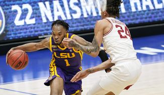 LSU's Ja'Vonte Smart (1) drives against Arkansas' Ethan Henderson (24) in the first half of an NCAA college basketball game in the Southeastern Conference Tournament Saturday, March 13, 2021, in Nashville, Tenn. (AP Photo/Mark Humphrey)