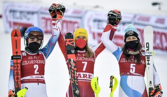 From left, second placed, United States' Mikaela Shiffrin, winner, Austria's Katharina Liensberger and third placed, Switzerland's Wendy Holdenercelebrate, after the second run of a Women's slalom Alpine World Cup ski race in Are, Sweden, Saturday March 13, 2021. (Pontus Lundahl, TT via AP)
