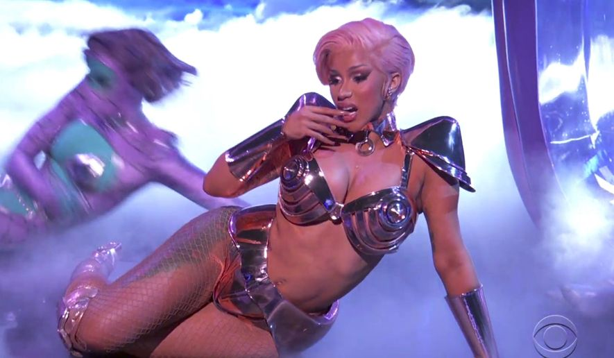 """In this video grab provided by CBS and the Recording Academy, Cardi B performs """"WAP"""" at the 63rd annual Grammy Awards at the Los Angeles Convention Center on Sunday, March 14, 2021. (CBS/Recording Academy via AP)"""